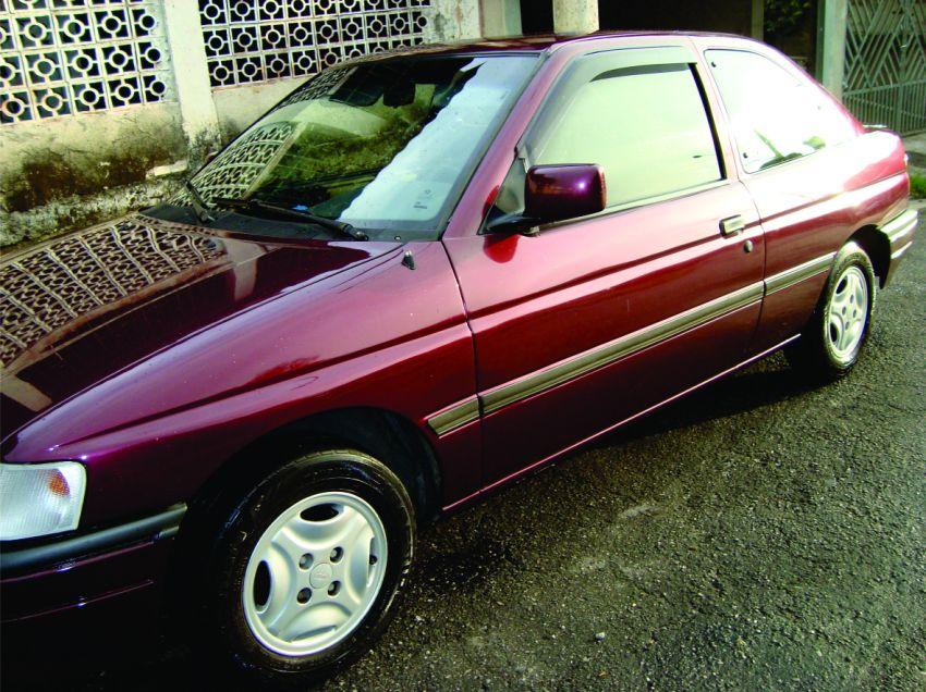 Ford Escort Hatch Ghia 1.8 - Foto #1