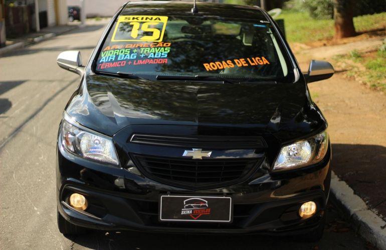 Chevrolet Onix 1.0 MPFi Seleção 8v - Foto #2