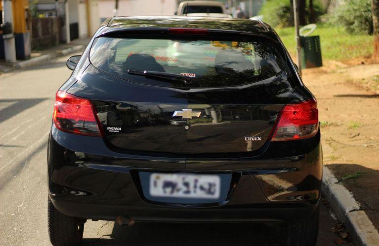 Chevrolet Onix 1.0 MPFi Seleção 8v - Foto #4